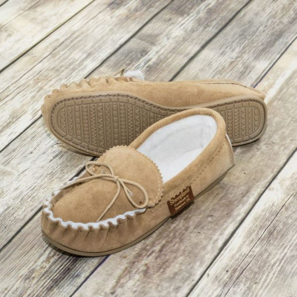 Handmade Sahara Sheepskin Moccasin Slippers on wooden background