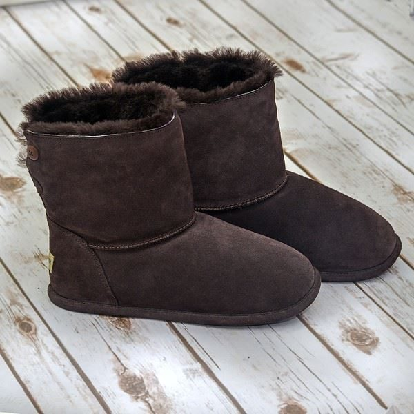 Chocolate Sheepskin Slipper boots on a white wooden floor