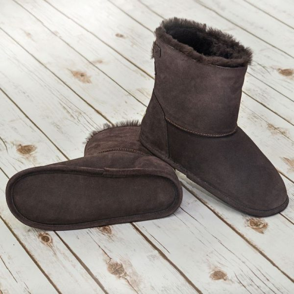 Chocolate Sheepskin Slipper boots on a white wooden background