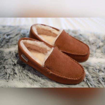 Ashley Unisex Sheepskin Slippers on a grey sheepskin rug