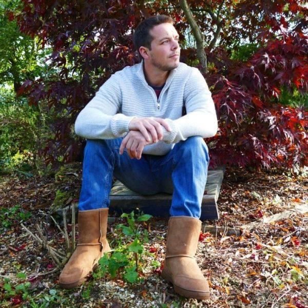 Sleepland sheepskin outdoor boots in tan, male model, autumn leaves