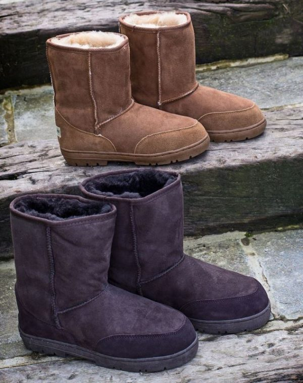 Sheepland classic outdoor boots in tan and brown on stone steps