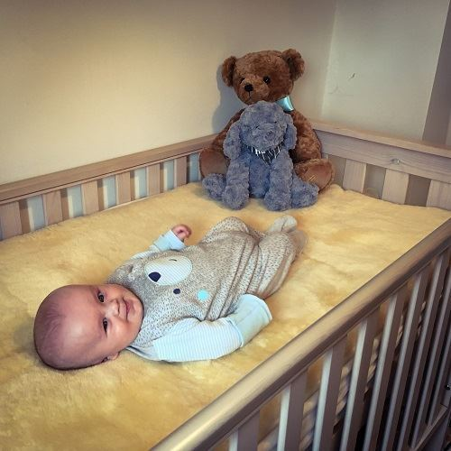 Baby on a Sheepskin Mattress Topper