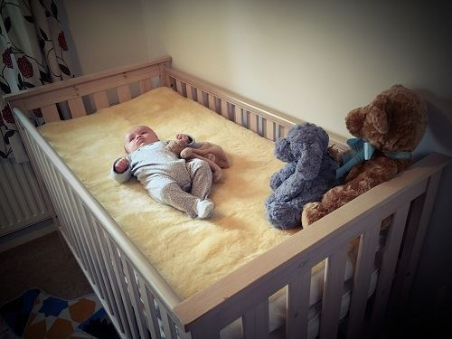 Sheepskin Baby Mattress Topper for a crib