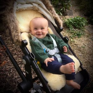 Baby Sheepskin Pushchair Liner with baby in pushchair