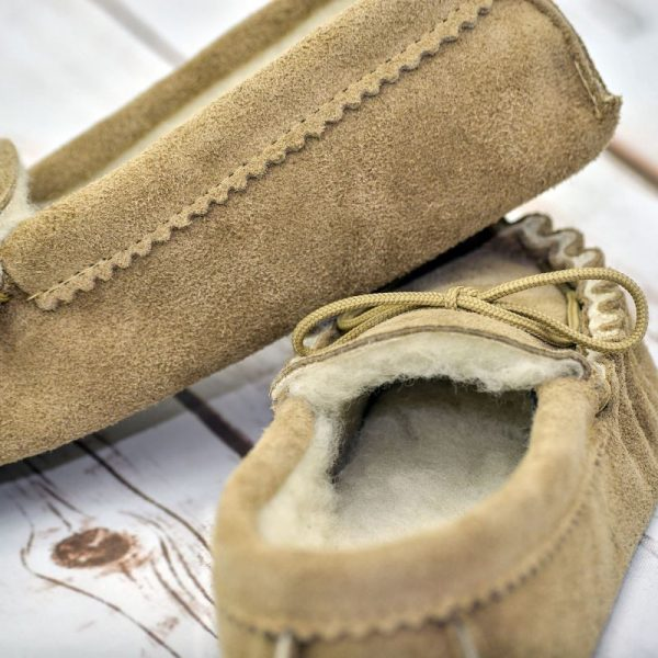 Beige British Made Suede Moccasin Slippers on white floor boards