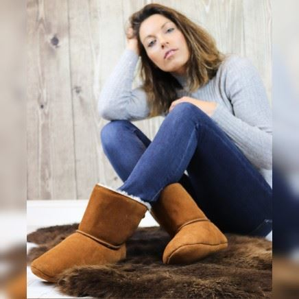 Luxury Sheepland Sheepskin Indoor Slipper Boots In Tan on Model cross legged