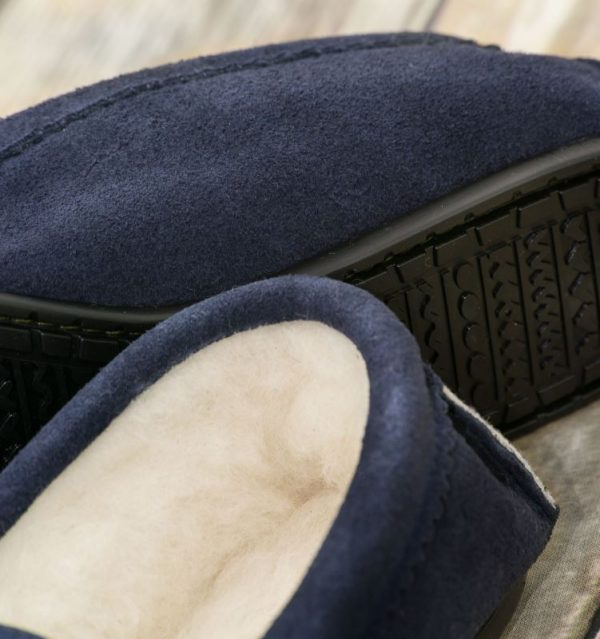 Navy British Made Suede Moccasin Slippers on wooden background
