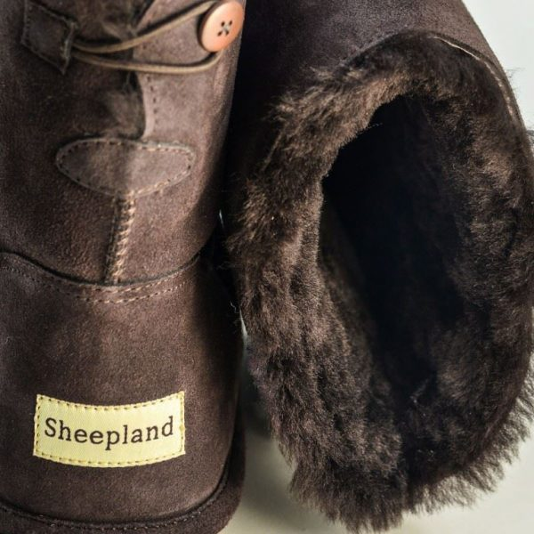 Chocolate sheepskin slipper boots, close up of the sheepskin collar and heel detail