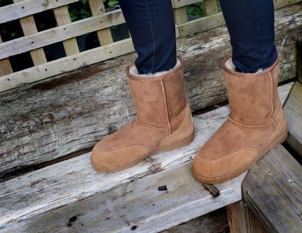 Tan Slim fit outdoor sheepskin boots, wooden background