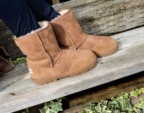 Slim fit sheepskin boots, on wooden bench