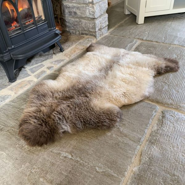 Undyed British Sheepskin Rug M71 by fireplace