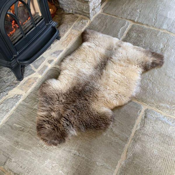 Organic Undyed British Sheepskin Rug M71 on flag stone floor