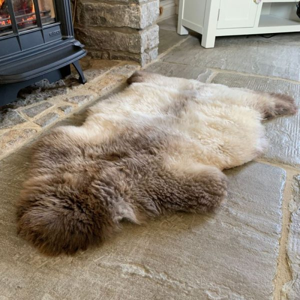 Undyed British Sheepskin Rug M71 in front of fireplace