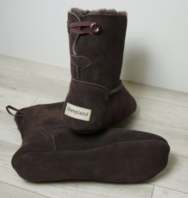 British made mocha house boots on a wooden background, toggle detail