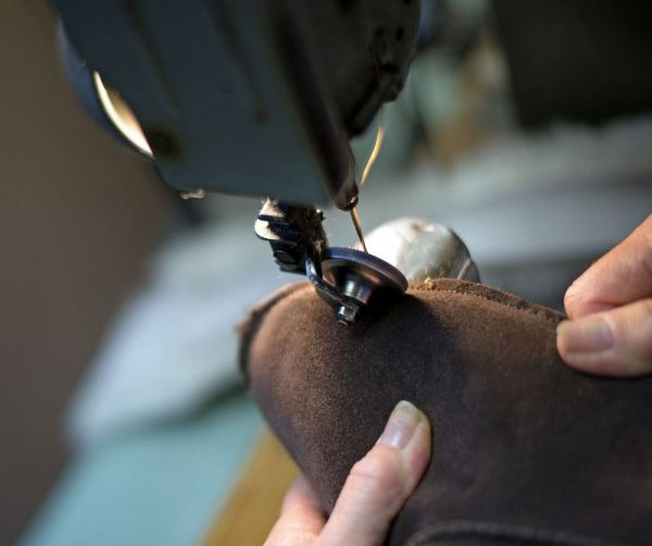 British made mocha house boots being stitched on a machine