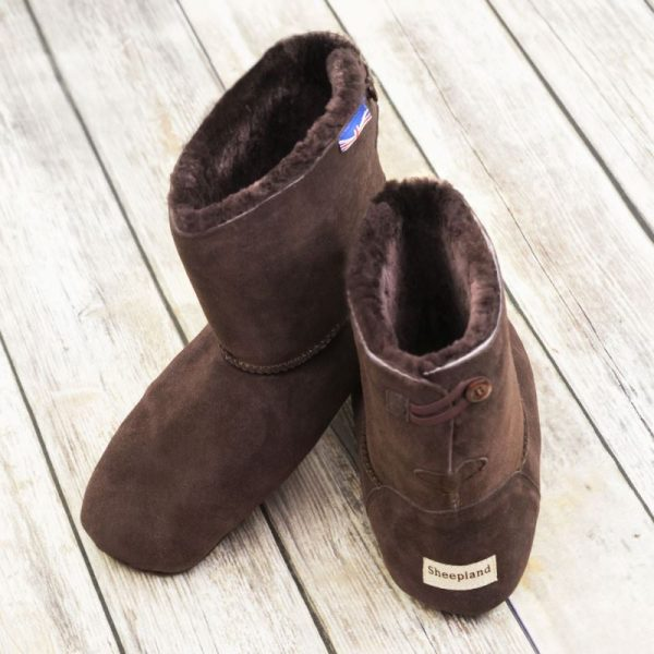 British made mocha house boots on a wooden background