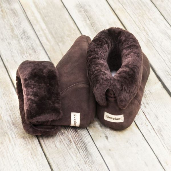 British made mocha house boots, on a wooden background with the fur collar rolled down