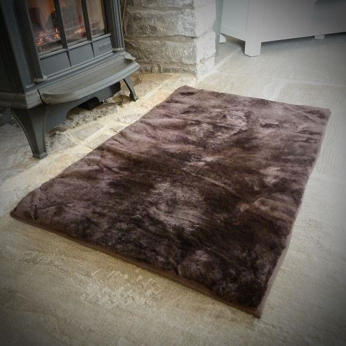 Sheepland Sheepskin Chocolate Pet Bed in lounge in front of fire place