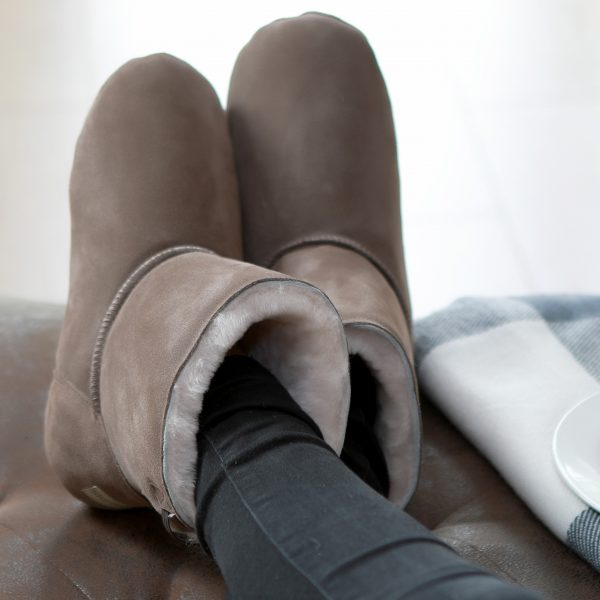 Pure sheepskin, the natural alternative to man-made textiles. Slipper boots, the answer to cold weather. Natural sheepskin wraps your toes in luxury.