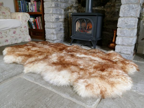 Sheepland Wolf Tipped British Sheepskin Quad Rug by Fireplace