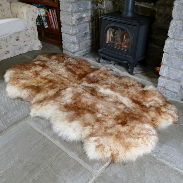 Sheepland Wolf Tipped British Sheepskin Quad Rug by Fireplace